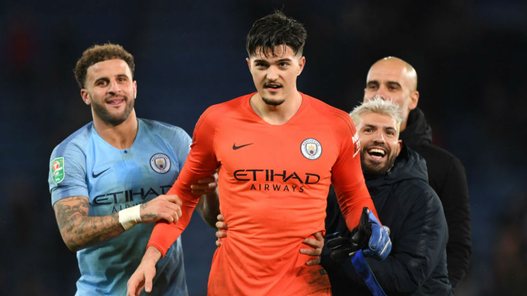 ORANGE CRUSH : Sergio Aguero and Kyle Walker hail  'keeper Aro Muric after the victory over Leicester