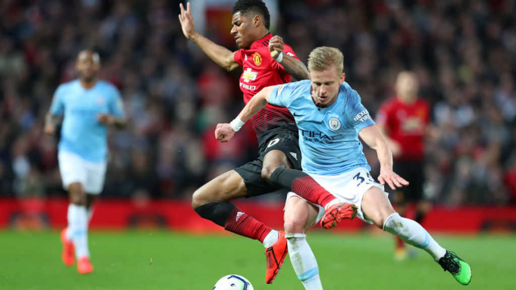 COLLISION COURSE : Oleks Zinchenko and Marcus Rashford are at full throttle