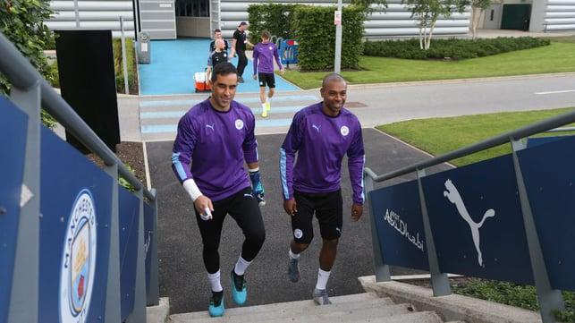 OFF TO WORK : Claudio Bravo and Fernandinho make their way to training