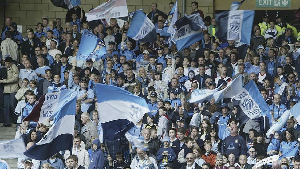 FLYING THE FLAG: The City fans show their true colours