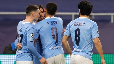 TEAM: Jesus and Foden celebrate with Bernardo after his goal.