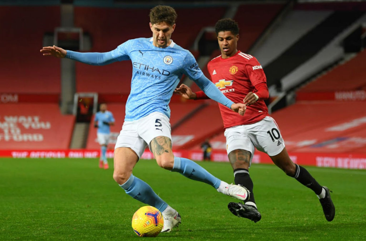 CENTRE OF ATTENTION: John Stones snuffs out the threat of Marcus Rashford