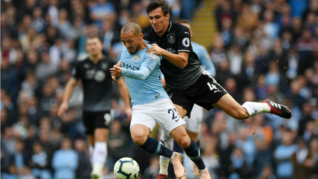 SOLID SILVA : David Silva looks to wriggle free from Burnley's Jack Crok