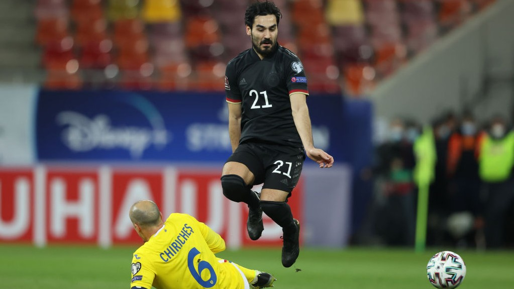 MIDDLE MARCH: Ilkay Gundogan in action for Germany away to Romania