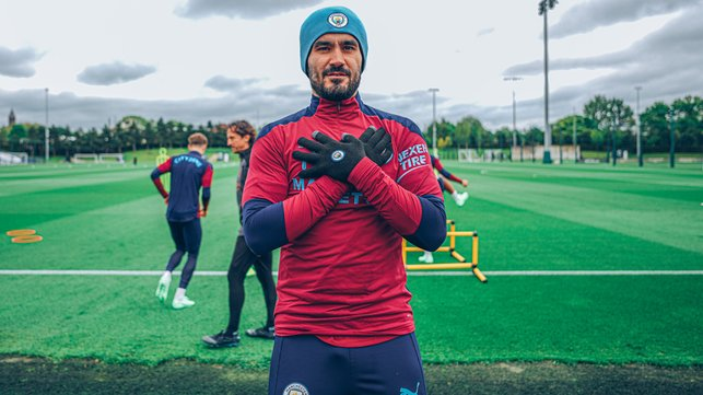 THAT'S A WRAP: Ilkay Gundogan wraps up warm for the session