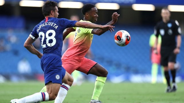 BUSY BOY : Sterling seeks to escape the attention of Chelsea's Azpilicueta early on.