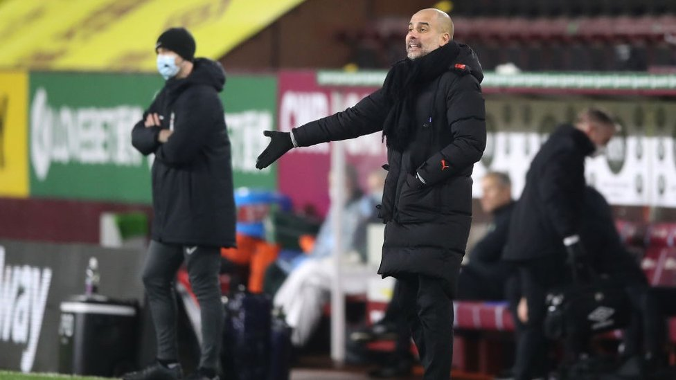 PEP TALK : The boss gives out his orders from the sideline.