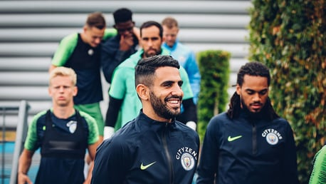 FOCUS: Riyad Mahrez heads out onto the training pitches with his new team mates.