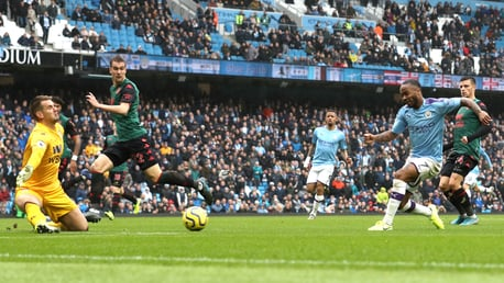 MAN ON FIRE: Raheem Sterling strikes a minute after the restart, firing into the near post
