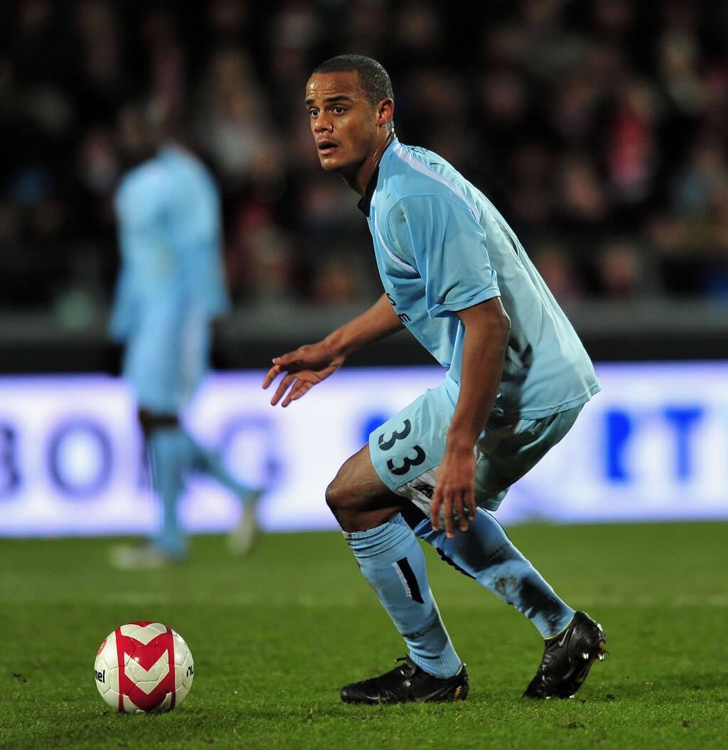 AALBORG, DENMARK - MARCH 19: Vincent Kompany of Manchester City runs with the ball during the UEFA Cup, Round of 16, Second Leg match between Aalborg and Manchester City on March 19, 2009 in Aalborg, Denmark.