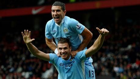 SIX APPEAL: Edin Dzeko celebrates after sealing City's remarkable 6-1 demolition derby win at Old Trafford in October 2011
