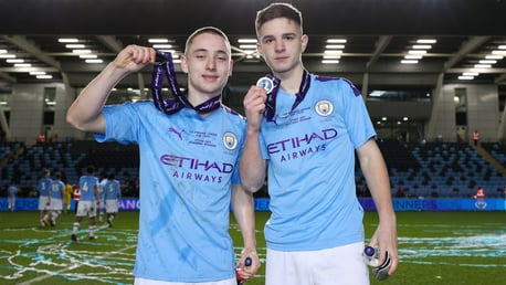 Joe Hodge (left) celebrates Manchester City's 2019/20 U18 Premier League Cup win.