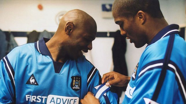 LEADING MAN: Sylvain Distin hands the captain's armband to Shaun Goater ahead of the final game