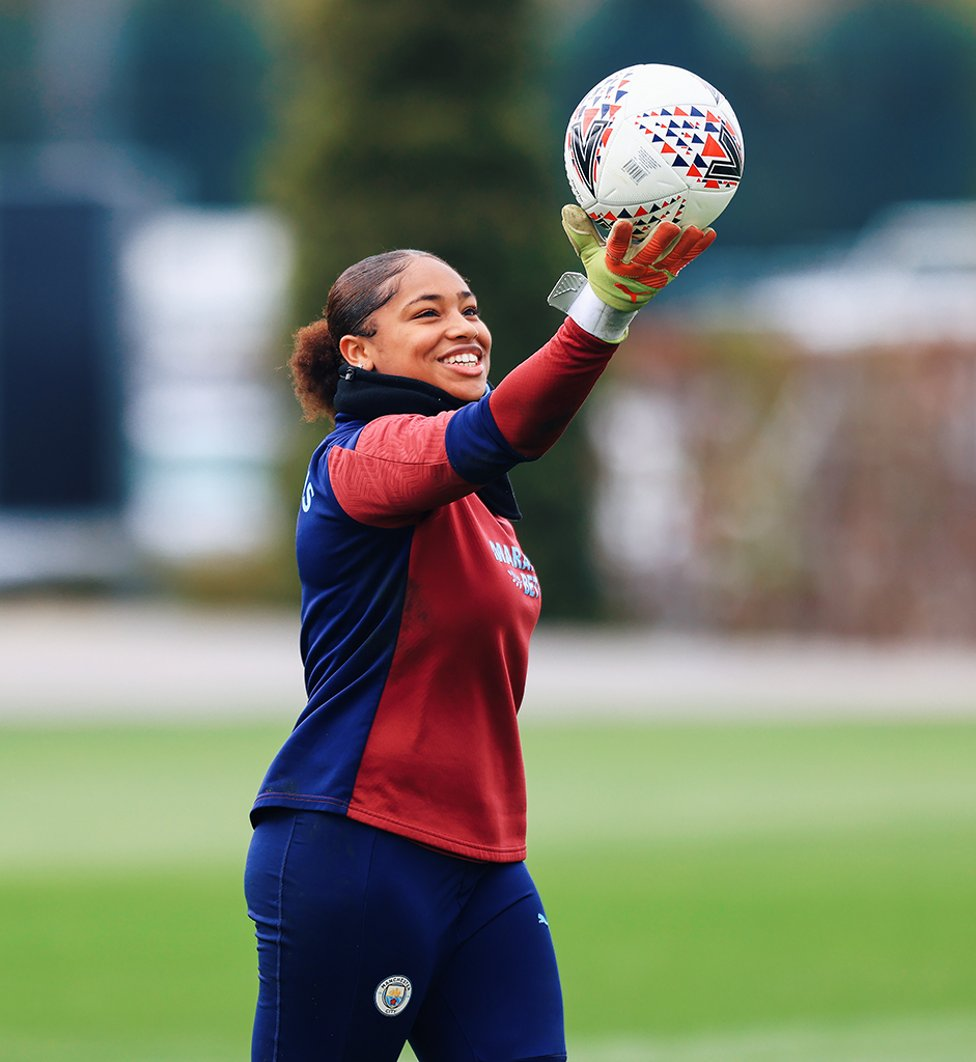 SAFE HANDS : Get yourself someone who looks at you how Khiara looks at a football!