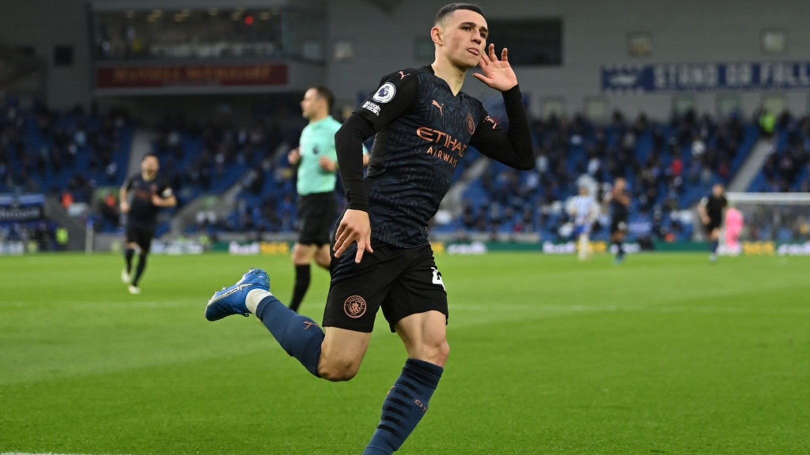 BABY SHARK: Foden wheels away to celebrate his stunning goal.