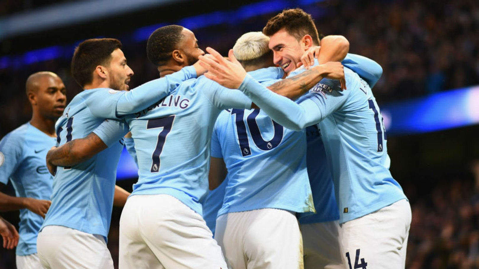 BLUES: The City players celebrate during the win over Arsenal