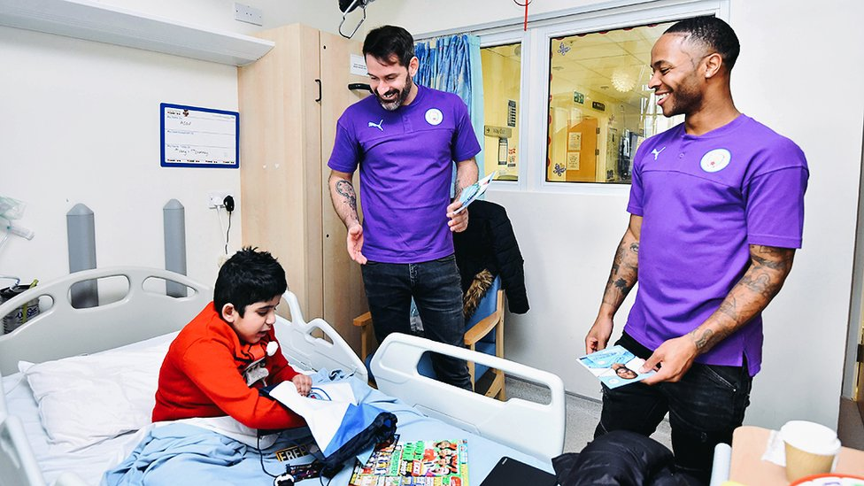 CHRISTMAS GENEROSITY : An early present from Scott Carson and Raheem Sterling