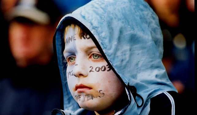 TIME TO REFLECT: This young fan takes in the emotional scenes