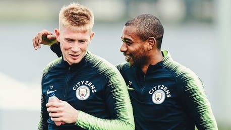 TWO'S COMPANY: Something has tickled Fernandinho and Kevin De Bruyne
