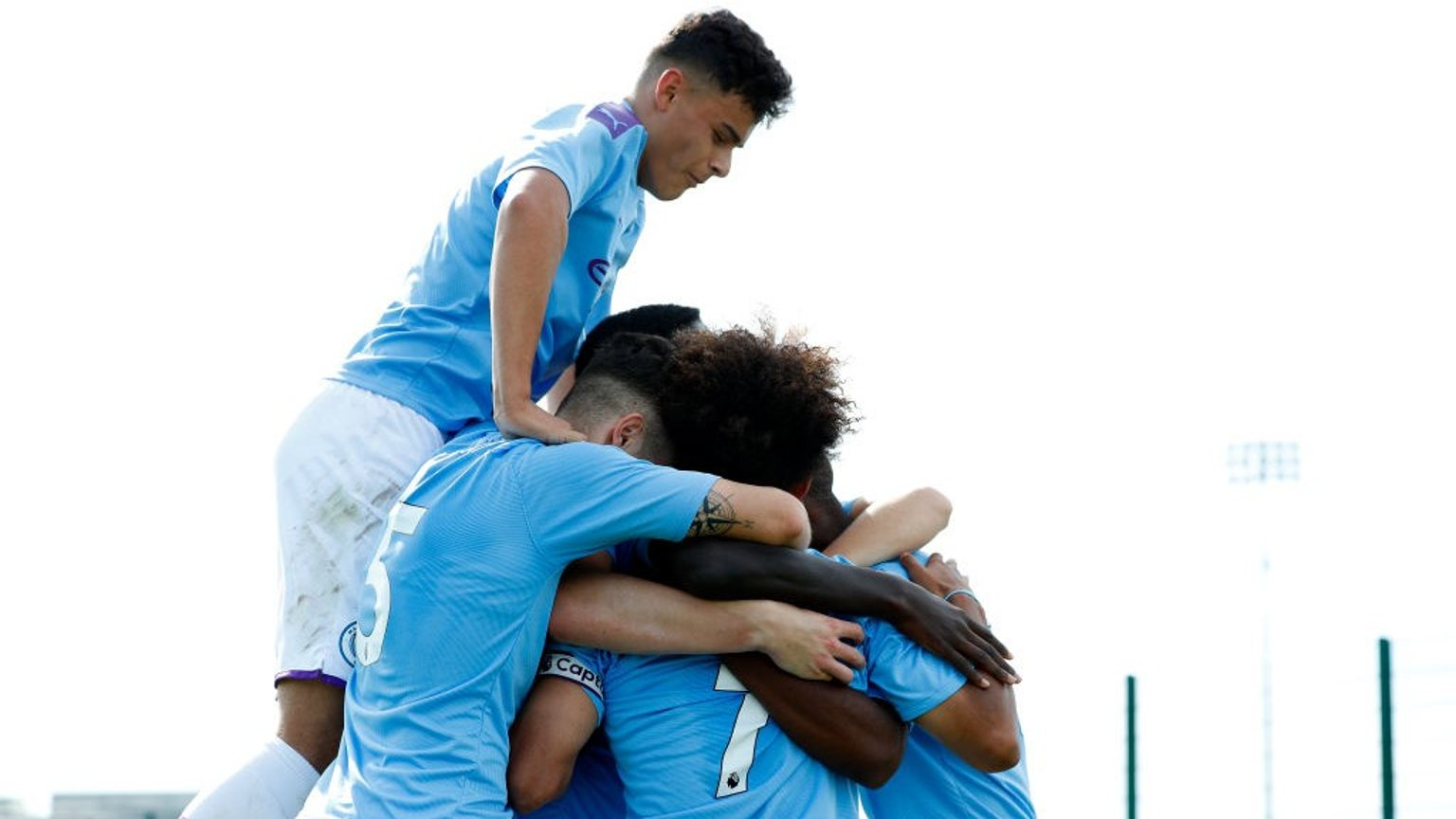 JUMPING FOR JOY: City U18s celebrate at the City Football Academy.