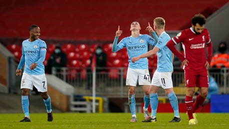 ONE OF OUR OWN: Foden celebrates as City coast to our first win at Anfield since 2003!