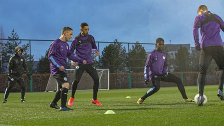 RAIN MEN: The City Under 18s squad train ahead of our Under 18 Premier League Cup final against Stoke on Tuesday