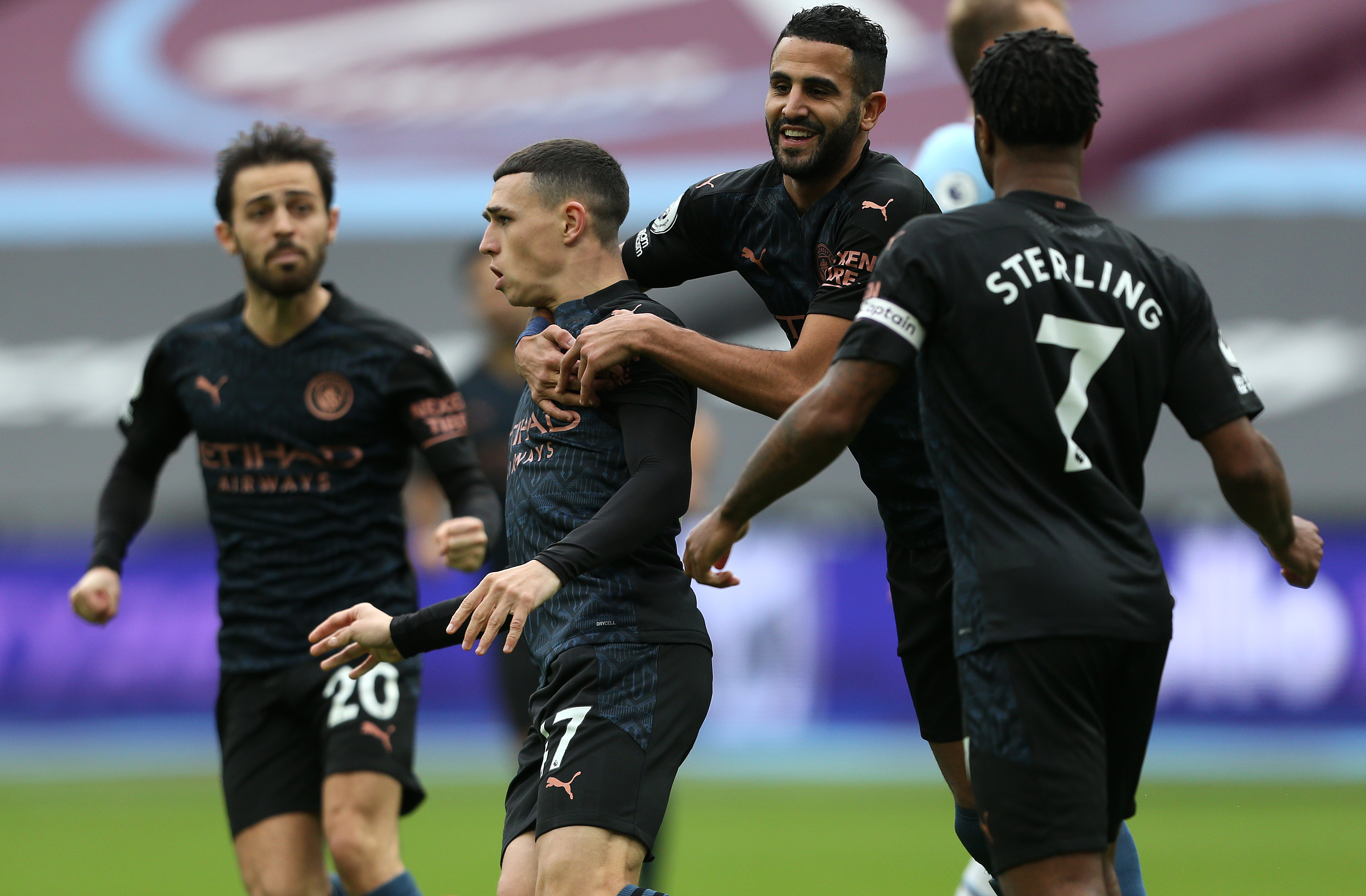 LEVEL BEST: Phil Foden is mobbed by his team mates after scoring