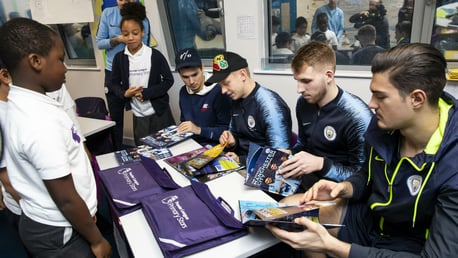 EXTRA RHYME: Manchester City players show poetry skills as they visit school for Premier League Writing Stars