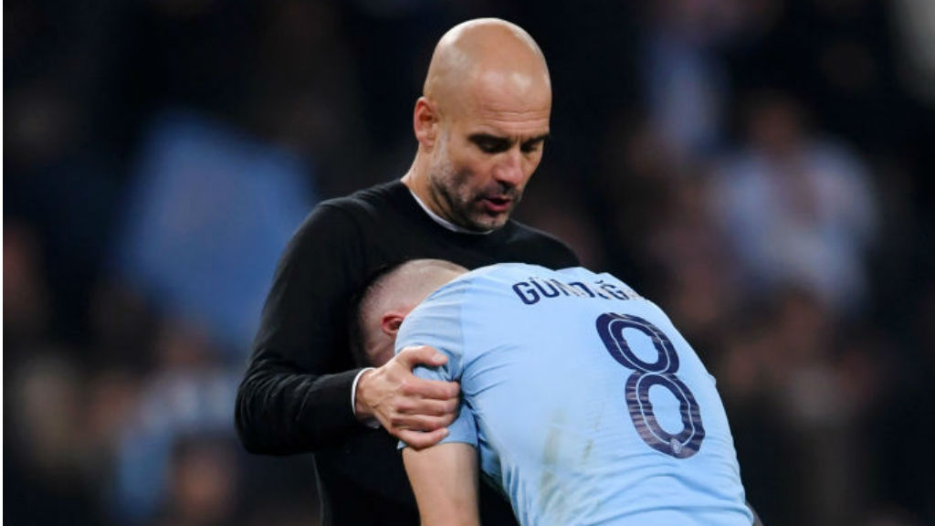 REACTION : _Pep Guardiola consoles Ilkay Gundogan after the final whistle