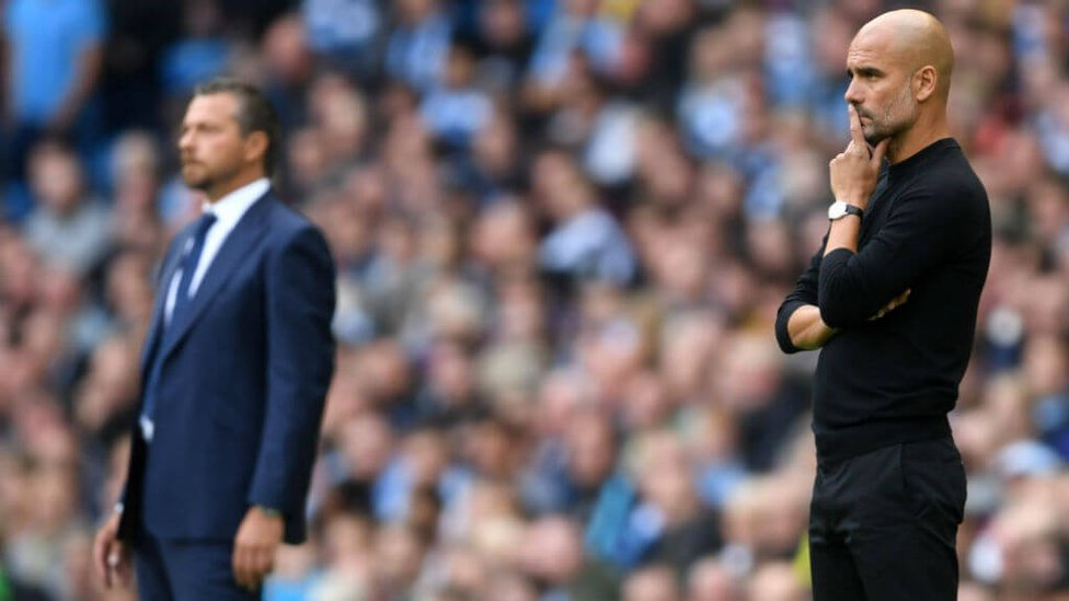 DUGOUT VIEW : The two managers watch on