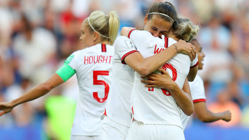 SHEER JOY : Jill Scott celebrates with her team-mates after her early goal
