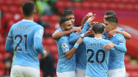 ON THE MARK: Kyle Walker is mobbed by his City team-mates after breaking the deadlock
