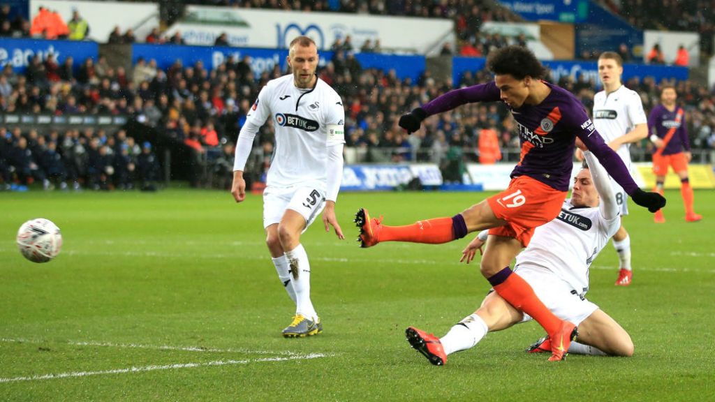 CLOSE CALL : Leroy Sane unleashes a left-foot shot on the Swansea goal