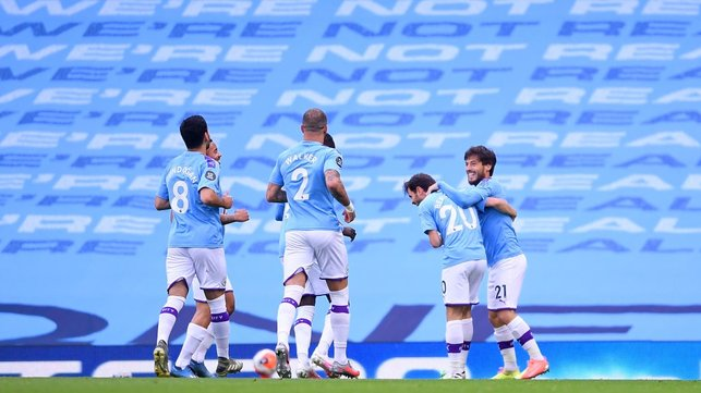 CAPTAIN FANTASTIC : The players rush to congratulate the skipper after his superb goal.
