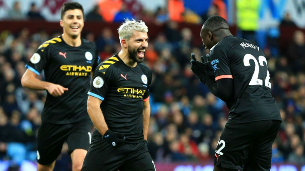 RECORD BREAKER : Aguero and Benjamin Mendy get the party started at Villa Park after Sergio's historic 12th Premier League hat-trick, eclipsing Alan Shearer's all-time record