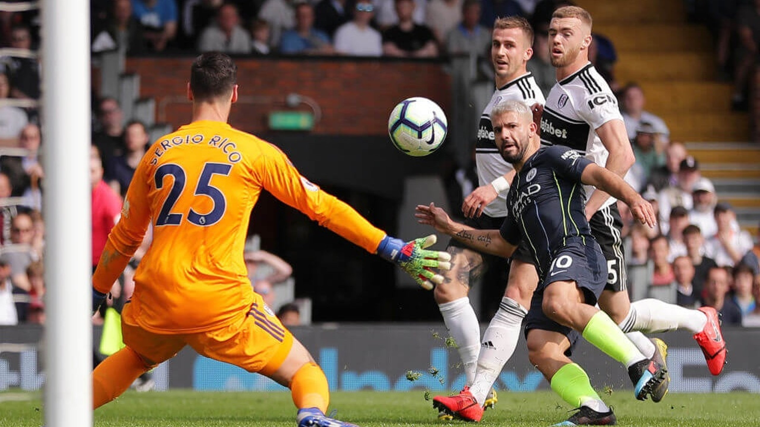 LIFT-OFF: Sergio Aguero places the ball over Rico to double City's lead