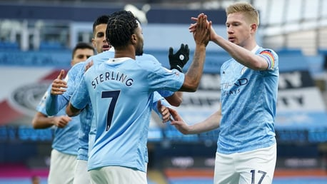 SHARE THE LOVE: The players flock to Sterling to congratulate him after the opener.