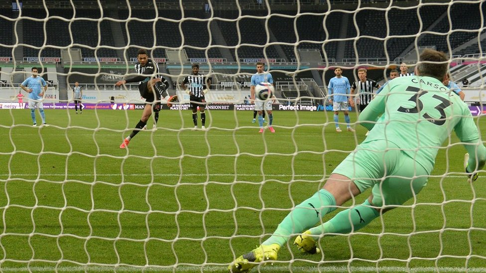 PENALTY: Scott Carson guesses right, but can't quite get to Joelinton's penalty on the stroke of half-time