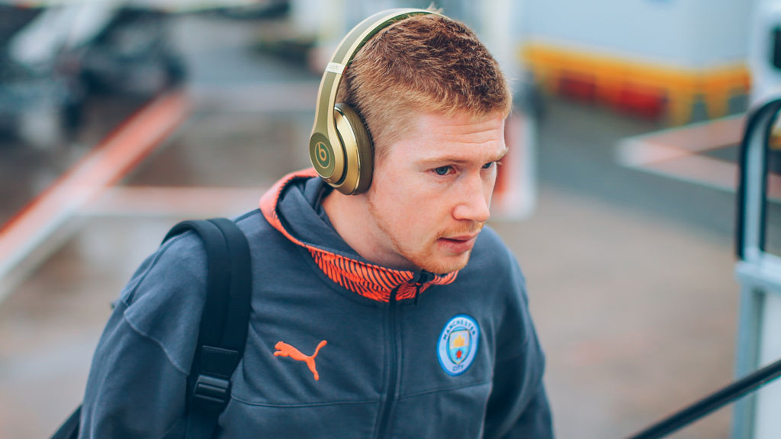EAR WE GO: Kevin De Bruyne sported some nifty headphones ahead of departure