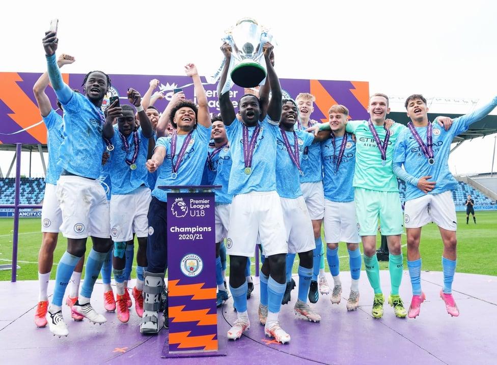 NATIONAL CHAMPIONS: Skipper Kwaku Oduroh proudly lifts the Premier League Under-18 National trophy aloft