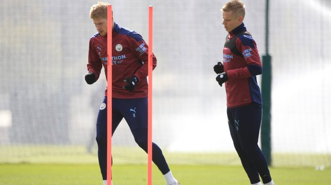 DOUBLE TROUBLE: Kevin De Bruyne and Oleksandr Zinchenko limber up