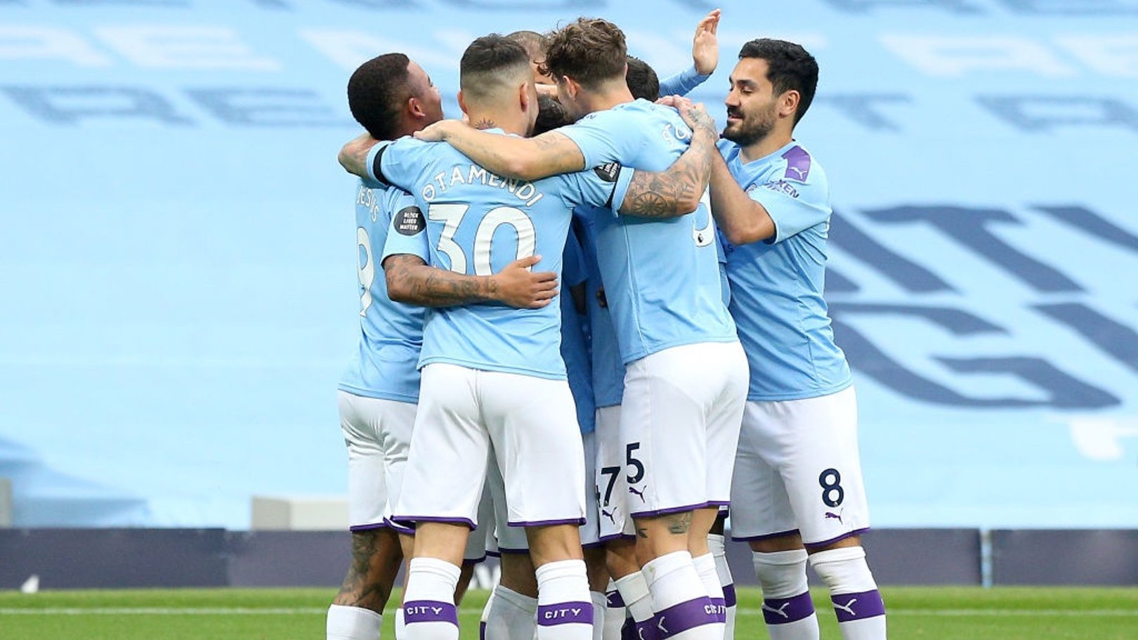 GROUP HUG: The players share the love after Silva's early goal.