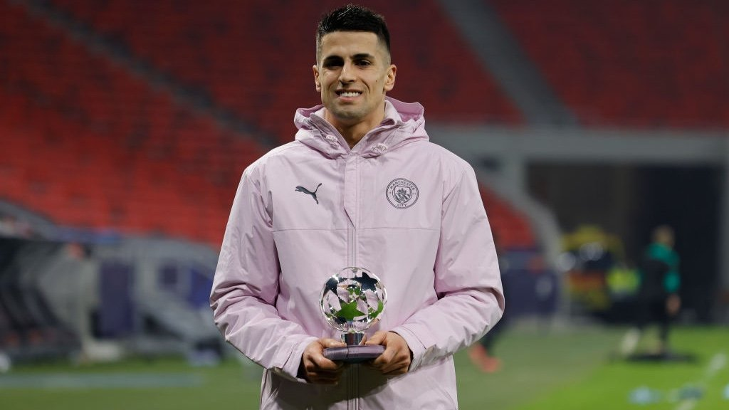 STAR MAN: Cancelo receives his award after a superb display.