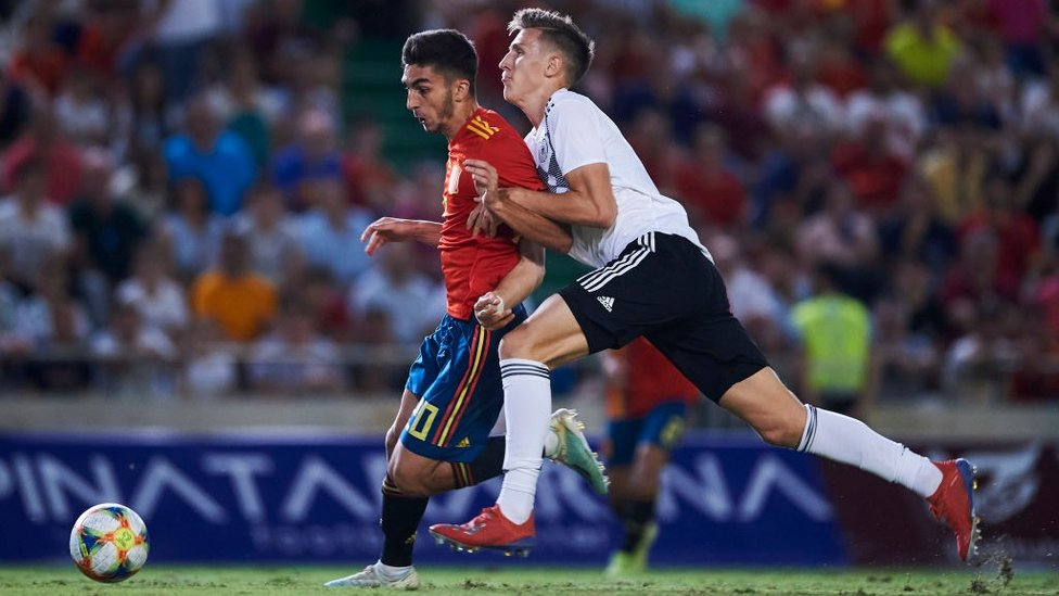 LA ROJA : Driving forward with Spain U21s in friendly against Germany. Torres was also capped at U17 and U19 level.