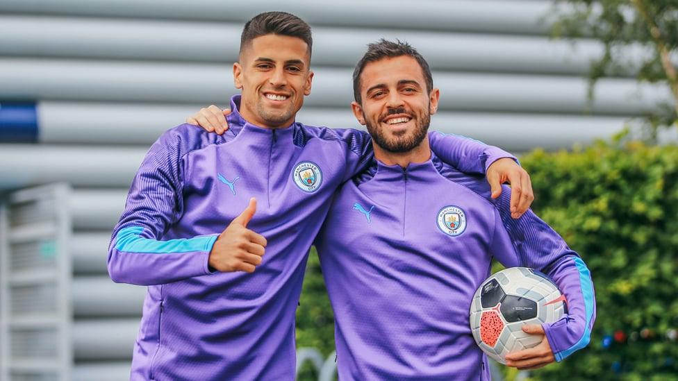 PLEASED TO BE BACK : Joao Cancelo and Bernardo Silva are all smiles ahead of training