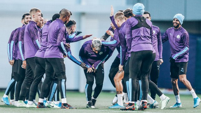 TUNNEL VISION : Sergio Aguero is mobbed by his teammates