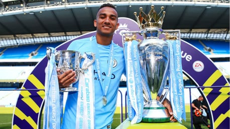 IMPRESSIVE HAUL: Danilo poses next to the Premier League and Carabao Cup in May 2018