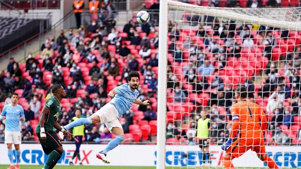 STRETCH : Gundogan pulls every muscle to reach the ball but his header loops over in the second half.
