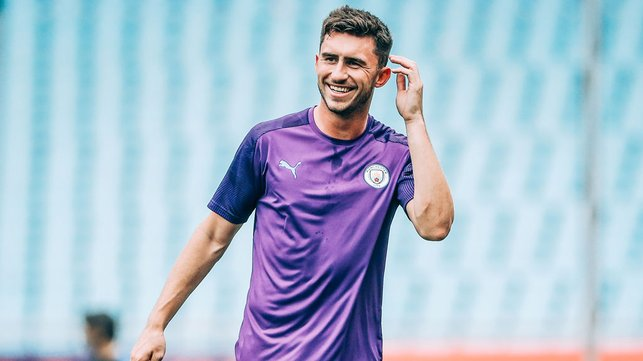 HIGH SPIRITS : Aymeric Laporte flashes a smile.
