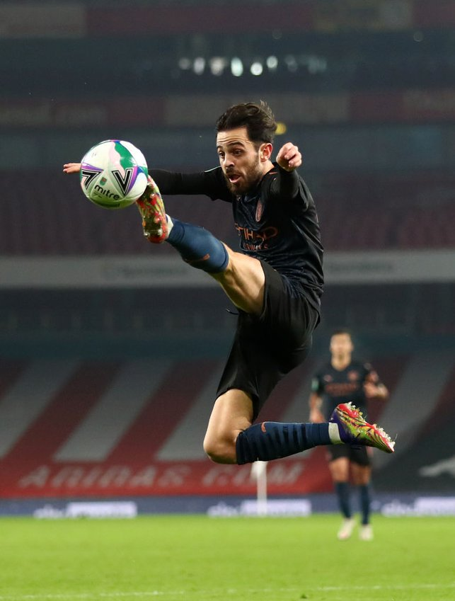 SILVA STRETCH: Bernardo Silva looks to get on the end of an aerial ball
